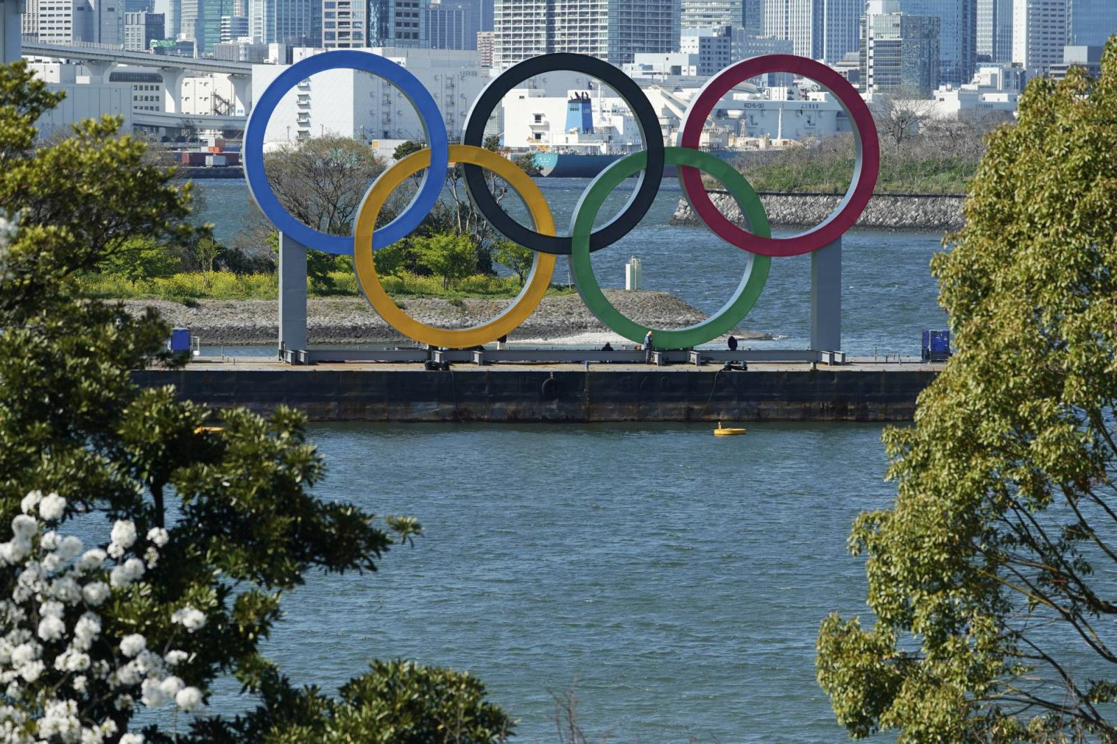 The Olympic rings are seen in Tokyo's Odaiba waterfront district on March 24. | AP