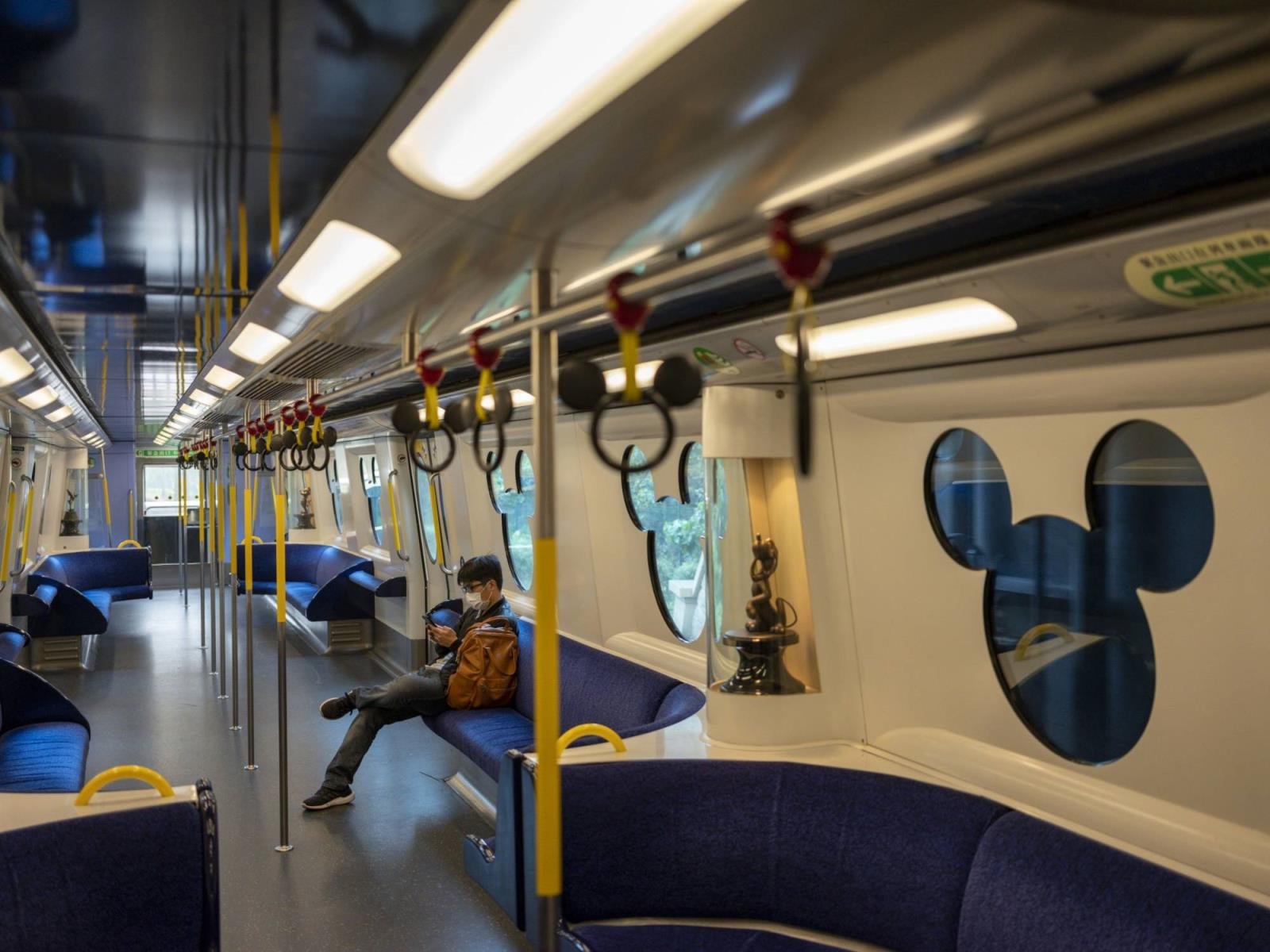 A passenger rides on the Disneyland Resort line in Hong Kong in March.   BLOOMBERG